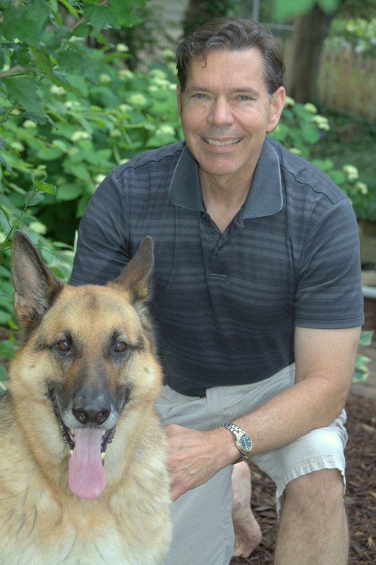 Pictureo f Dr Duane Kiley with his dog Max