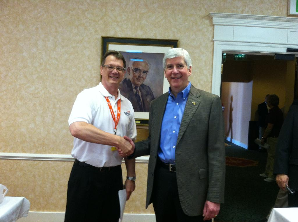 This is a picture of the program instructor shaking hands with Michigan Governor Rick Snyder at the Skills USA convention