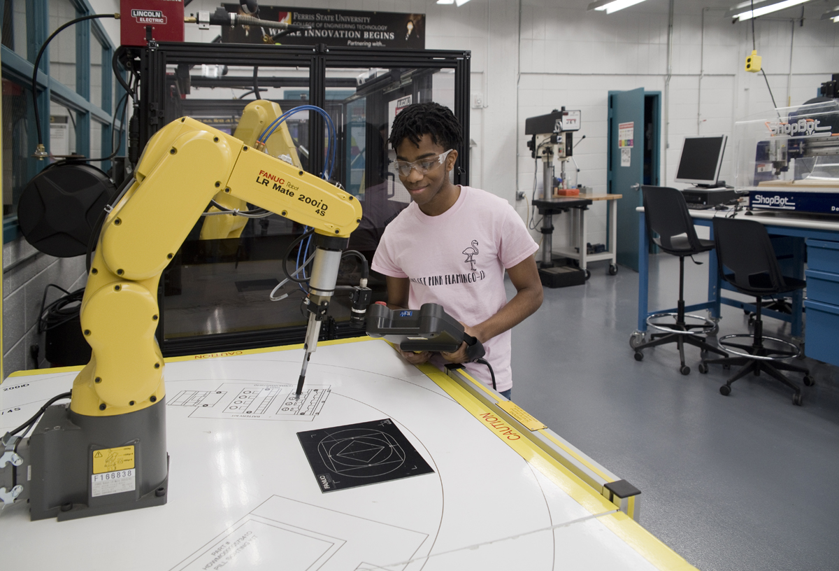 Student working with robotic arm