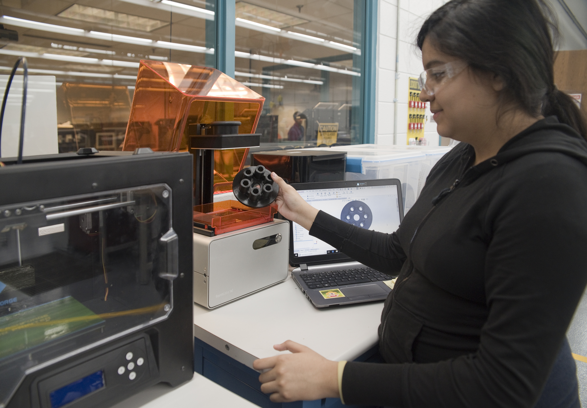 girl with 3d part, printers, and CAD model