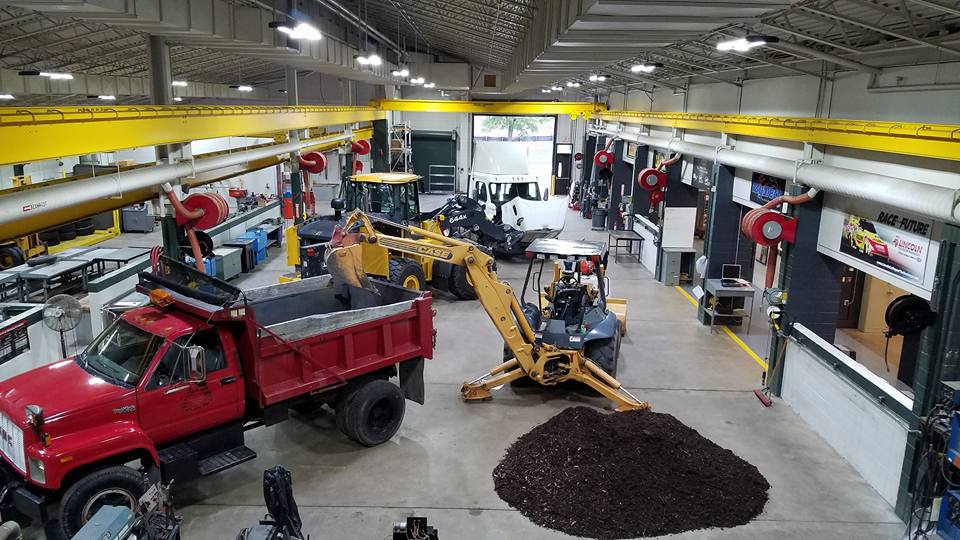 View of open house with machines on display