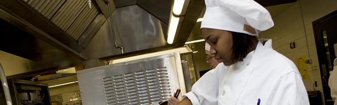Picture of hospitality student working in kitchen
